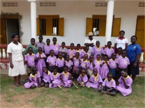 Headteacher and school pupils at Kakunyu